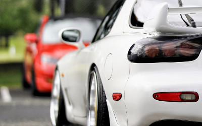 White Mazda RX7 with japanese import car insurance