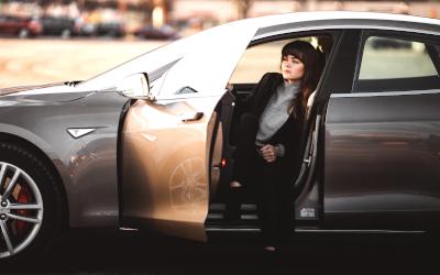 Woman in company car